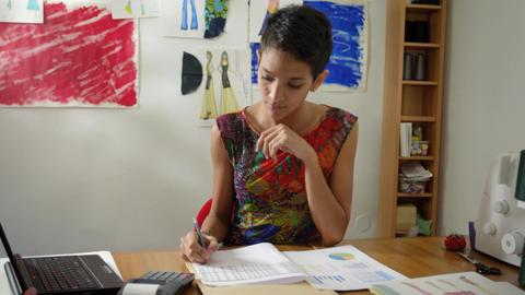 Hispanic Woman Doing Budget In Fashion Designer At stock footage