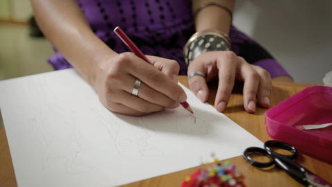 Young Female Fashion Designers Drawing New Dresses Footage