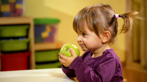 Little Girl Eating Green Apple Footage