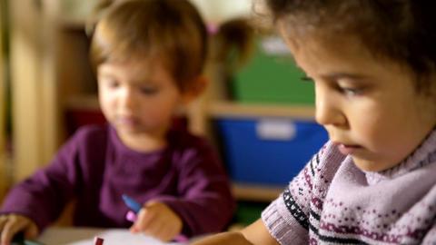 Two Preschoolers Drawing In Kindergarten stock footage