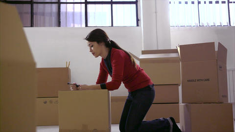 Woman Packing Cardboard Boxes Footage