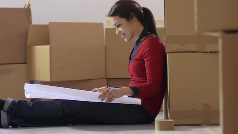 Woman Holding Plan with Cardboard Boxes Stock Video Footage