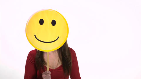 Woman holding smiley face emoticon Footage