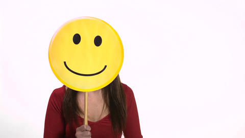 Woman holding smiley face emoticon Stock Video Footage