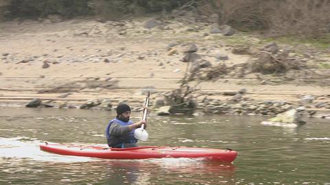 Tourist Canoeing In Lake, Sardinia, Italy Footage