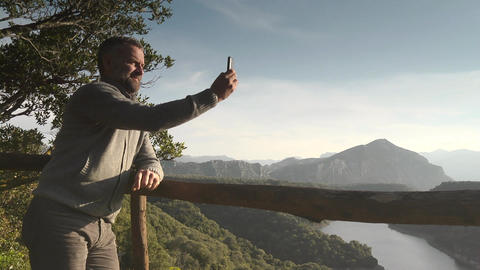 Man Tourist Viewing At Mountains Lake, Sardinia, Italy Footage