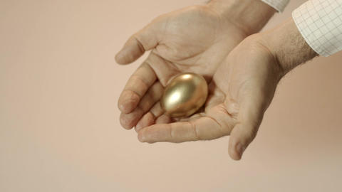 Man Showing Golden Eggs Stock Video Footage