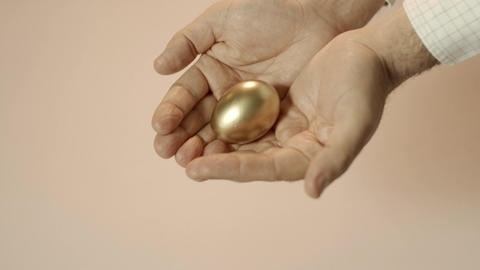 Man Showing Golden Eggs Sequence stock footage