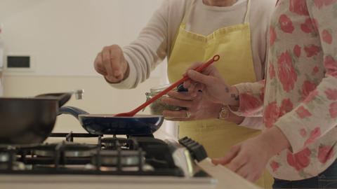 Mom And Daughter Cooking In Kitchen Stock Video Footage