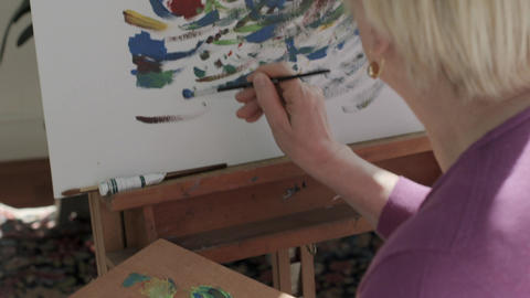Senior Woman Painting At Home Stock Video Footage