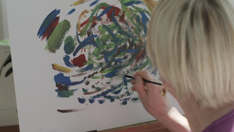 Senior Woman Painting At Home Footage