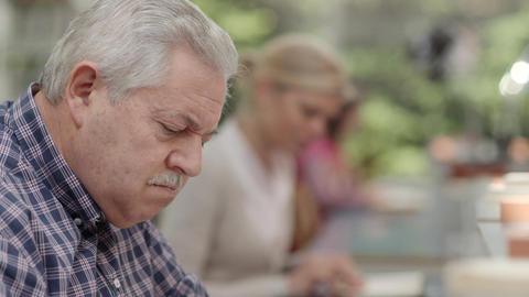 Senior man studying among young people in library Footage