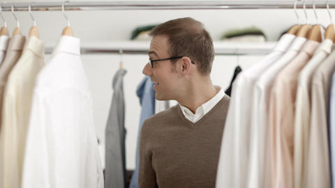 Man talking with salesclerk in clothes shop Stock Video Footage