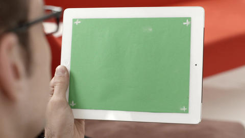 Man using digital tablet pc with green screen Stock Video Footage