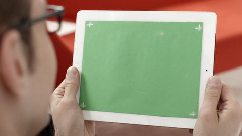 Man using digital tablet pc with green screen Footage