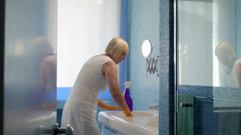 Senior woman doing chores in bathroom Stock Video Footage