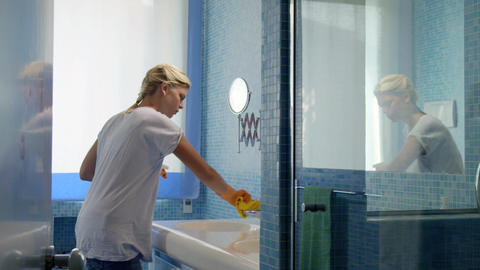 Young woman doing chores in bathroom Footage