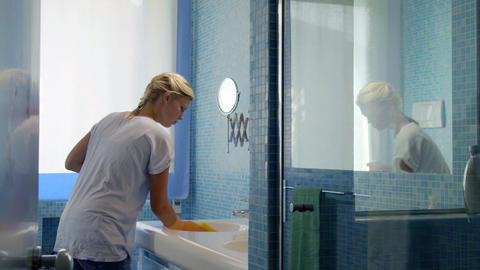 Young woman doing chores in bathroom Stock Video Footage