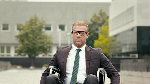 Portrait of happy businessman on wheelchair Stock Video Footage