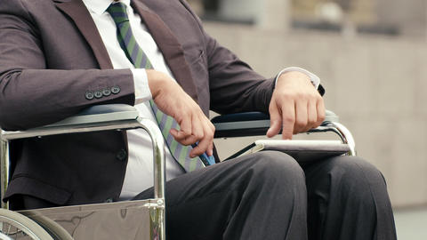 Businessman on wheelchair using tablet and talking Stock Video Footage