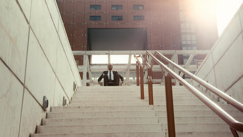 Businessman on wheelchair moving back from a stair Stock Video Footage