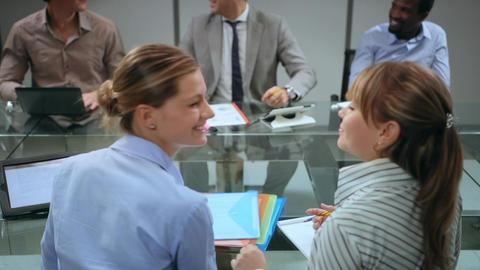 Team of happy business people having meeting in office Stock Video Footage