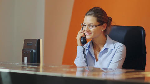 Businesswoman talking on telephone in office Footage