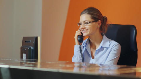 Businesswoman talking on telephone in office Stock Video Footage