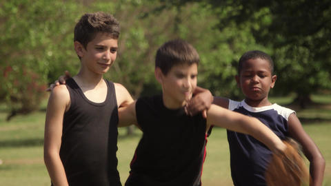 Three happy young boys with baseball smiling at camera Stock Video Footage