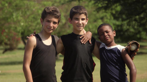 Three happy young boys with baseball smiling at camera Footage