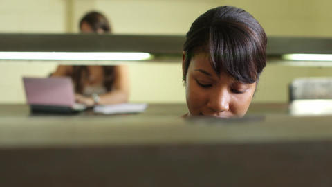 College library and female student young african american... Stock Video Footage