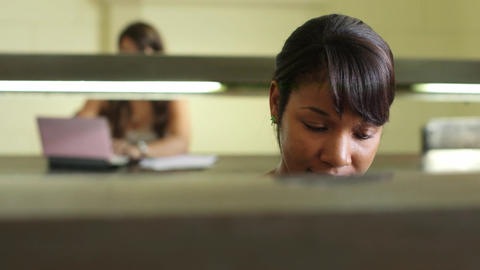 College library and female student young african american girl Footage