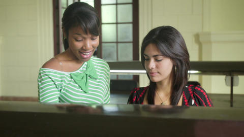Female students studying and doing homework in college Footage