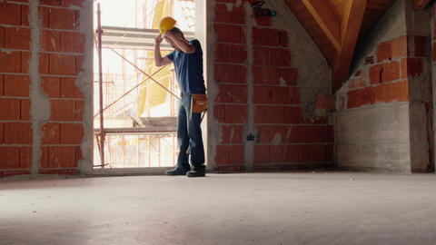 Construction Worker Dressing Helmet and Taking Tools and equipment Footage