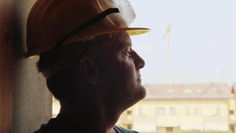 Construction Worker Contemplating New Building Stock Video Footage