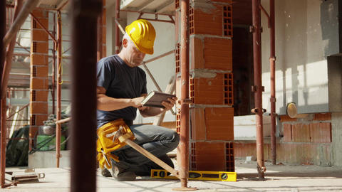 Construction Worker Using Level and Tablet Pc Stock Video Footage