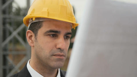 Architect in Construction Site Looking at Blueprint Stock Video Footage