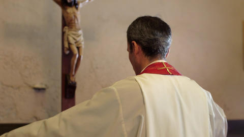 Hispanic Catholic Priest Dressing in Church Before mass Stock Video Footage