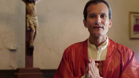 Hispanic Catholic Priest Dressing in Church Before mass Footage