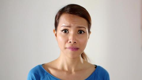 Asian Girl Hiding Behind Clock Stock Video Footage