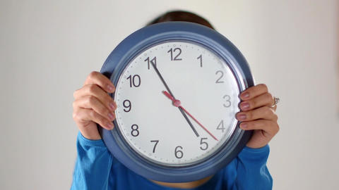 Asian Girl Hiding Behind Clock Live Action