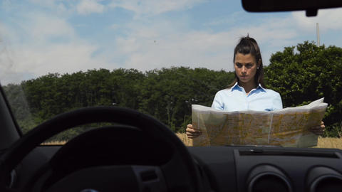 Female Car Driver Lost in The Country Reading Map Live Action