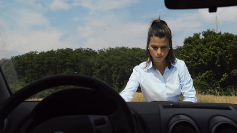 Female Car Driver Lost In The Country Reading Map stock footage