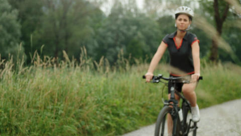 Portrait of Young Woman Cycling on Mountain Bike Stock Video Footage