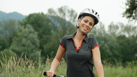 Portrait Of Young Woman Cycling On Mountain Bike stock footage