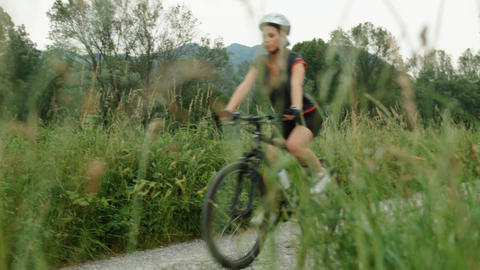 Young Woman Cycling and Training on Mountain Bike Stock Video Footage