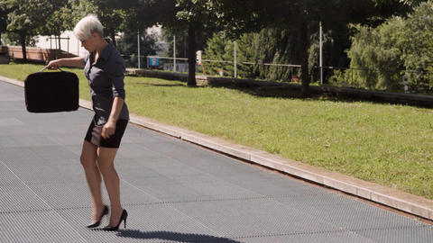 Business Woman Balancing on High Heels on Grating Stock Video Footage