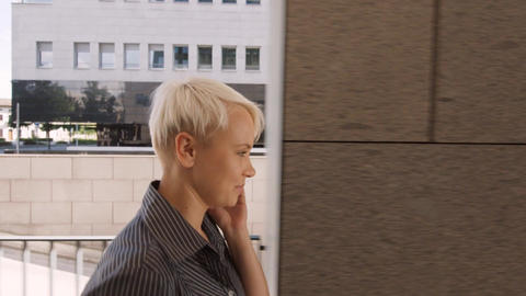 Businesswoman Walking Near Office and Talking on Phone Stock Video Footage