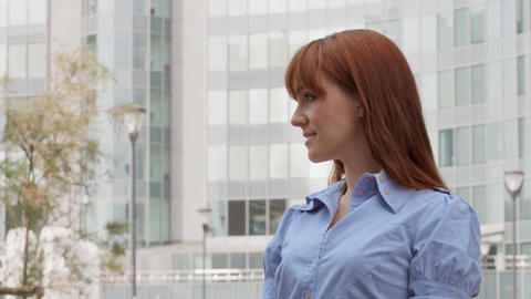 Confident Businesswoman Smiling at Camera Near Office Stock Video Footage