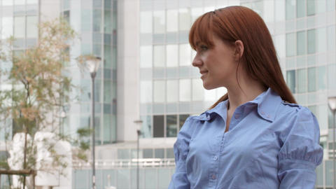 Confident Businesswoman Smiling at Camera Near Office Footage